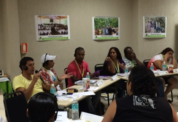 Farmworkers from multiple countries gather to share common issues.