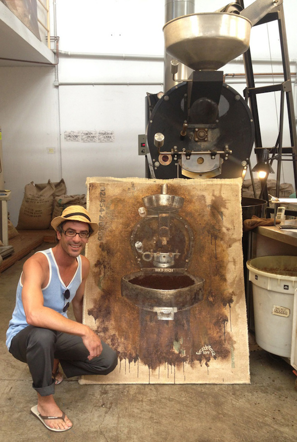 Fernando Mosca and a Diedrich roaster painted with spent coffee grounds. Photo courtesy of Sacred Grounds Organic and Fairtrade.