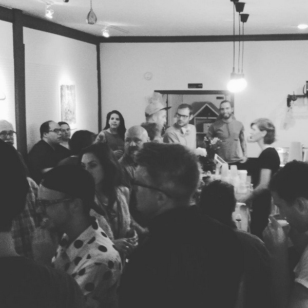 Hunckler behind the bar (right) at a League of Lattes latte art throwdown in collaboration with Bee