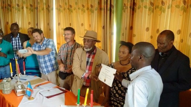 South Kivu Governor Marcellin Chisambo and Minister of Agriculture Adolphine Muley congratulate participants of Saveur du Kivu, along with organizers Beth Ann Caspersen (Equal Exchange), Richard Hide (Twin), Baraka Kasali (Eastern Congo Initiative), Chris Treter (On the Ground), and Butoto Naum (UGEAFI)