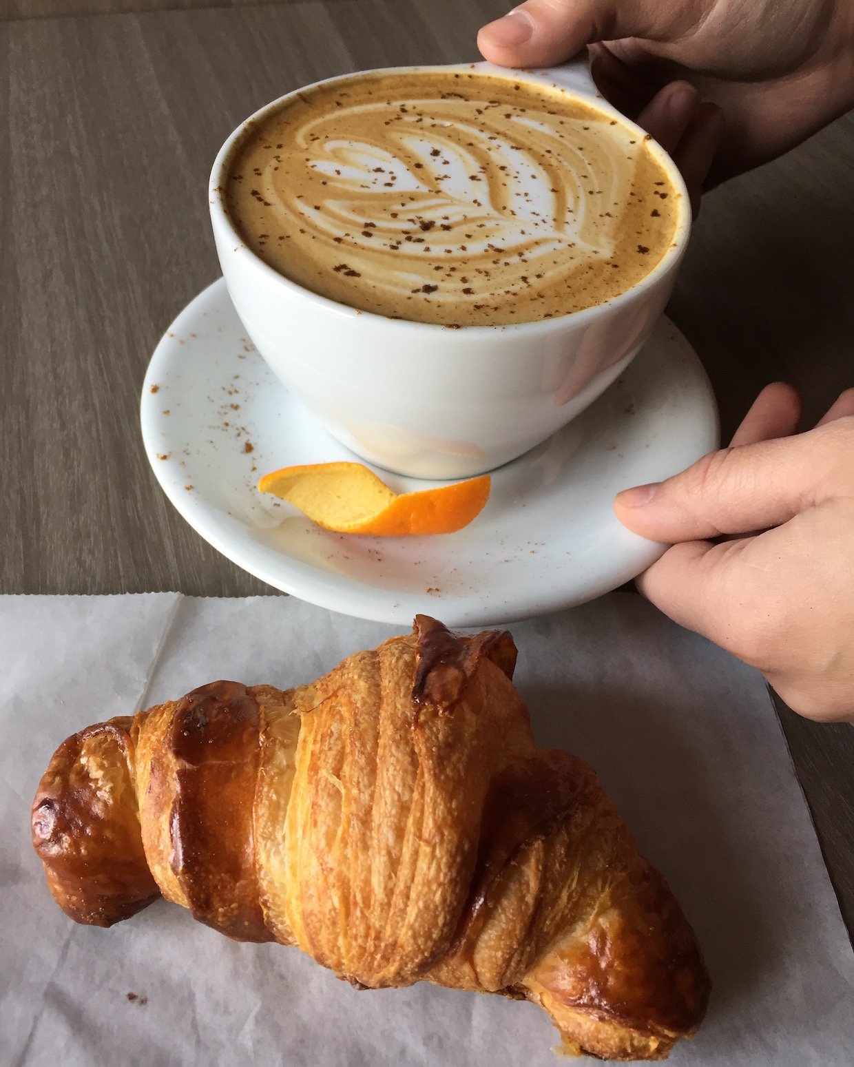croissant ant latte at coat check coffee indy