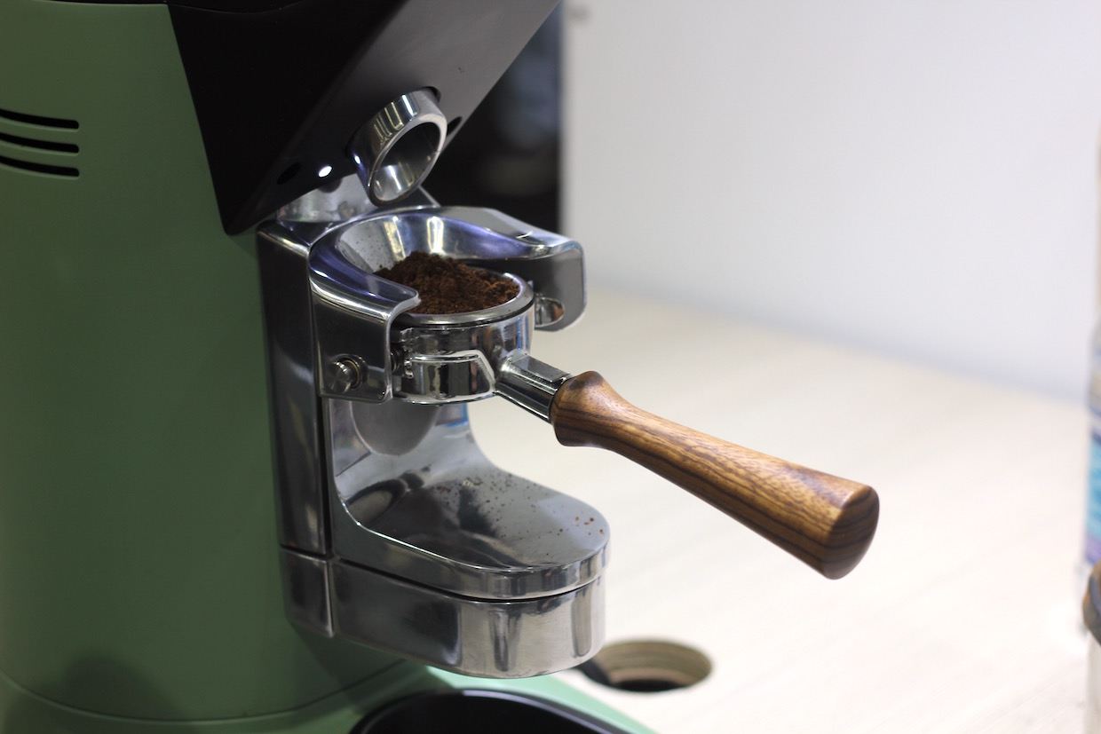 The portafilter holder on Compak's new PKF grinder. Photo by Nick Brown/Daily Coffee News.