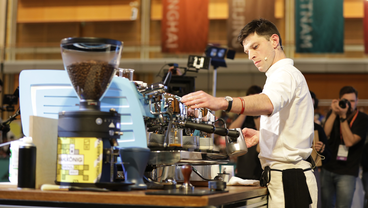 Here is a barista making coffee.