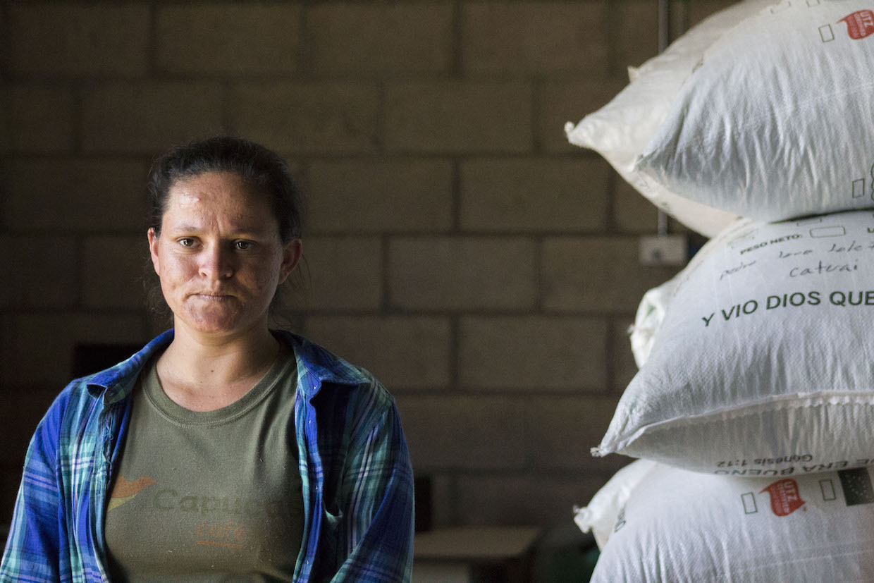 coffee farmer with bags